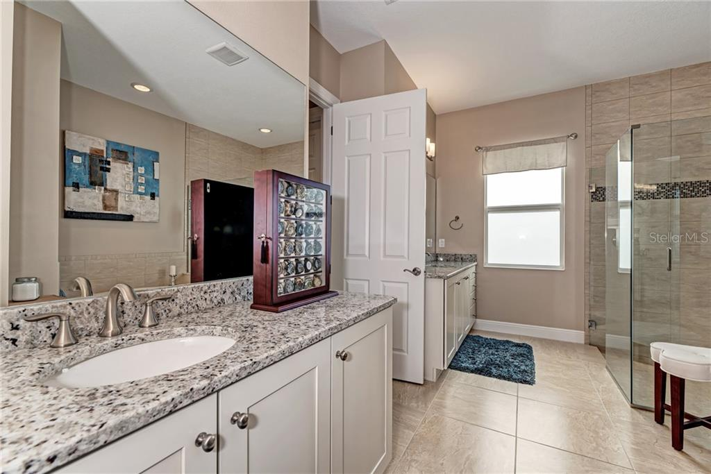 Master bathroom with dual sinks and granite counter tops - Single Family Home for sale at 5712 Tidewater Preserve Blvd, Bradenton, FL 34208 - MLS Number is A4424693