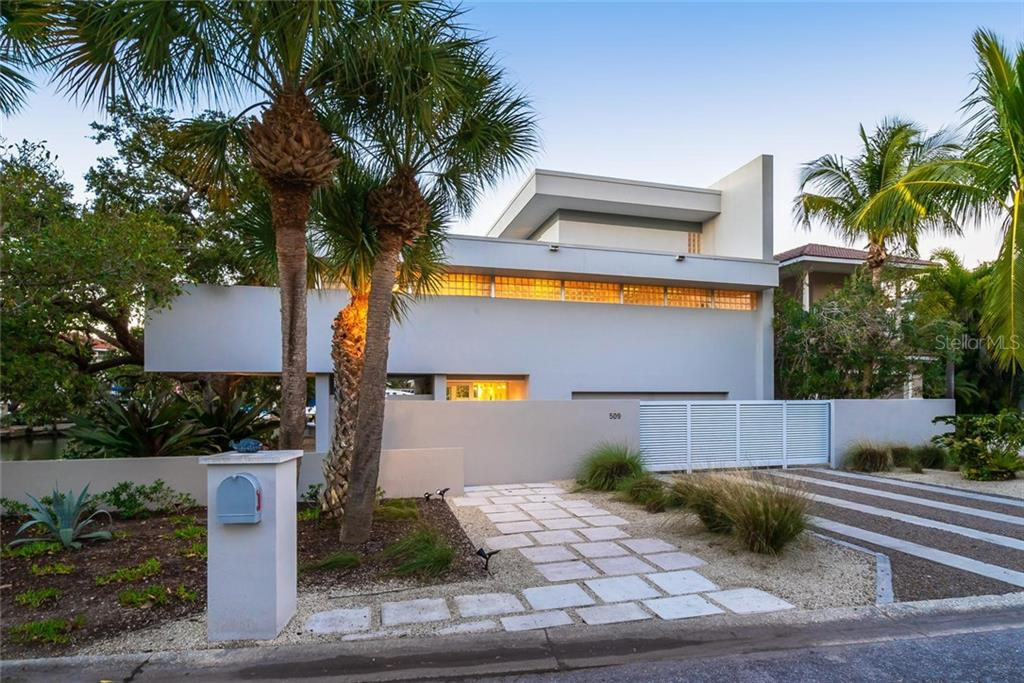 A beautiful modern front design with an automatic privacy gate to the garage and deco privacy walls to the front foyer! - Single Family Home for sale at 509 Venice Ln, Sarasota, FL 34242 - MLS Number is A4425092