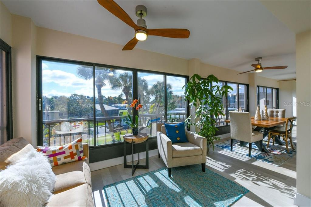 The lanai is where you will live!  Soak in the morning sunshine with a cup of coffee, and dine under the stars at night! - Condo for sale at 225 Hourglass Way #208, Sarasota, FL 34242 - MLS Number is A4425323
