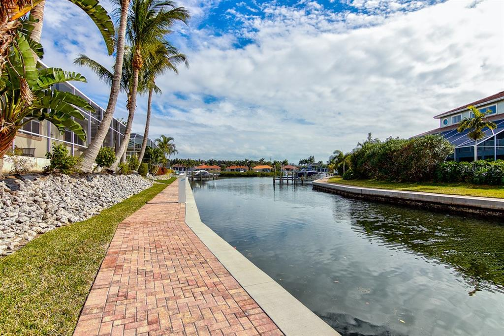 Canal is steps from the backyard. - Single Family Home for sale at 12518 Baypointe Ter, Cortez, FL 34215 - MLS Number is A4425873