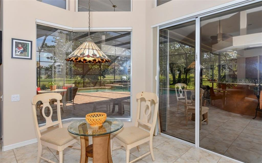 Light, bright breakfast area off the kitchen with a wonderful view - Single Family Home for sale at 7867 Estancia Way, Sarasota, FL 34238 - MLS Number is A4426528
