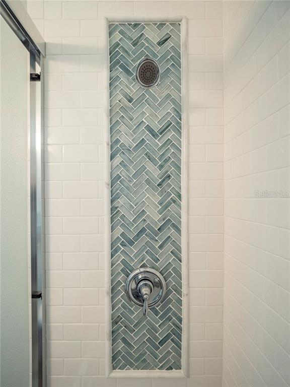 Pool bath shower with subway tile herringbone glass mosaic - Single Family Home for sale at 3611 4th Ave Ne, Bradenton, FL 34208 - MLS Number is A4426978