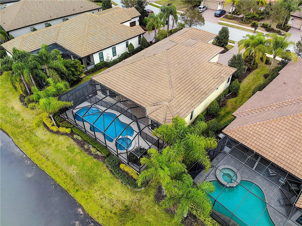Rear aerial view - Single Family Home for sale at 14640 Secret Harbor Pl, Lakewood Ranch, FL 34202 - MLS Number is A4427769