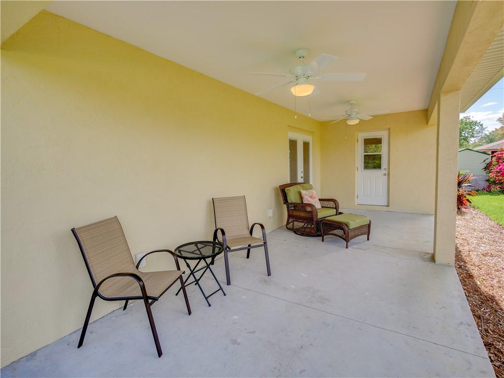 Enjoy views of the pond and sounds of nature from your covered lanai - Single Family Home for sale at 2558 Oneida Rd, Venice, FL 34293 - MLS Number is A4428145