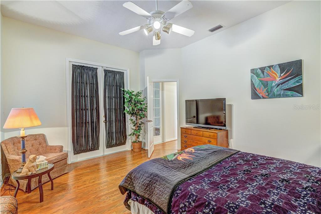 Guest bedroom also opens to florida room with dual glass paned doors - Single Family Home for sale at 6321 W Glen Abbey Ln E, Bradenton, FL 34202 - MLS Number is A4429610