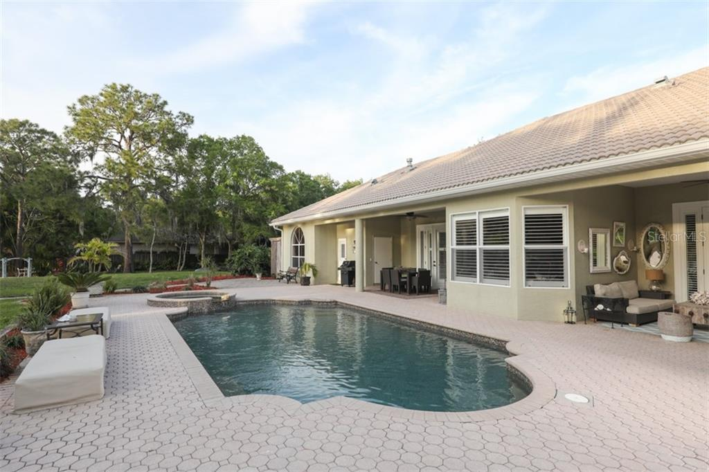 Single Family Home for sale at 8058 Desoto Woods Dr, Sarasota, FL 34243 - MLS Number is A4430014