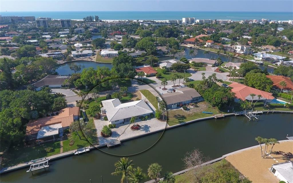 Shows the canal system which leads to the Intracoastal Waterway - Single Family Home for sale at 935 Contento St, Sarasota, FL 34242 - MLS Number is A4431223