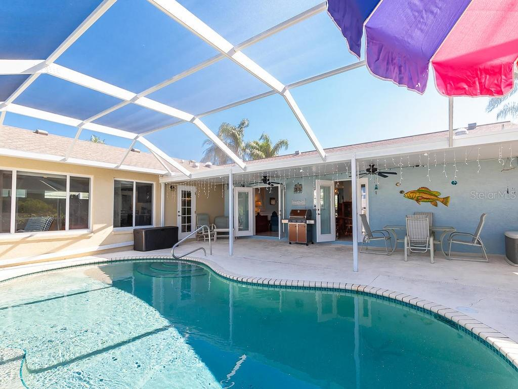 Spacious pool deck area offers both sun and shade for those hot days! - Single Family Home for sale at 4908 Coral Lake Dr, Bradenton, FL 34210 - MLS Number is A4431516