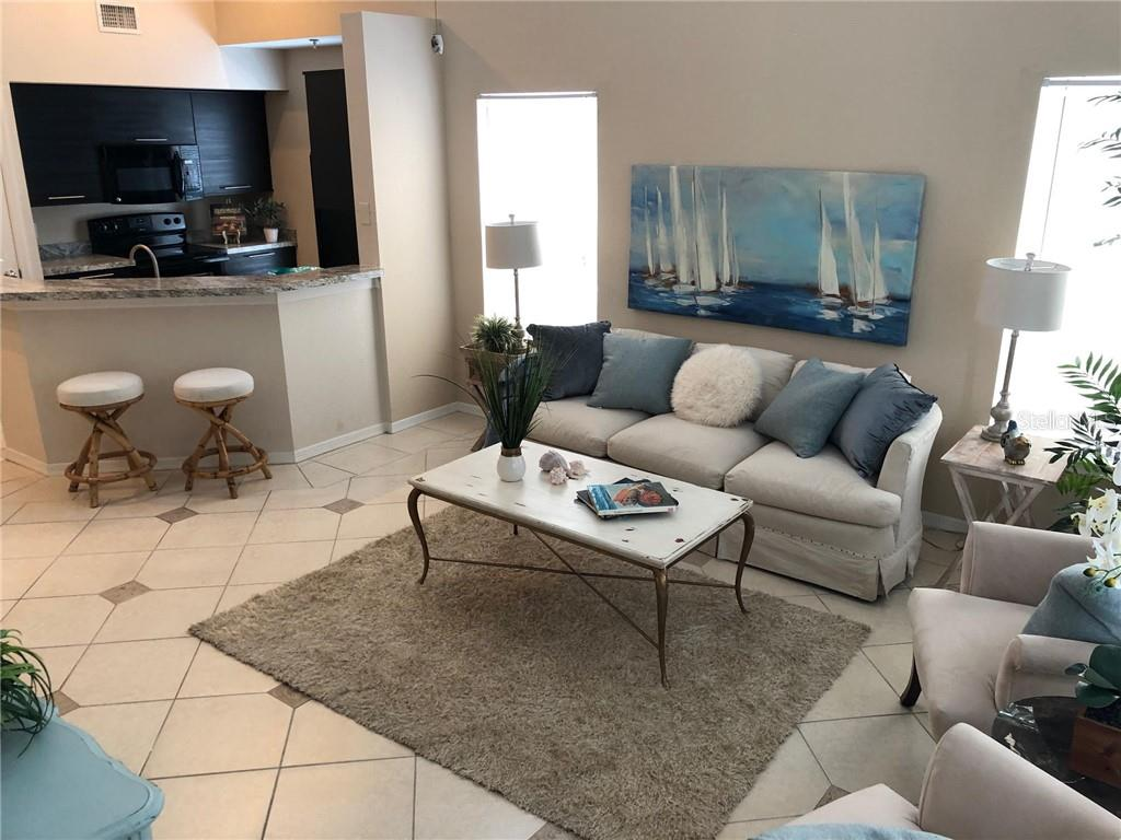 Living Room Off The Kitchen - Condo for sale at 5511 Rosehill Rd #201, Sarasota, FL 34233 - MLS Number is A4431621
