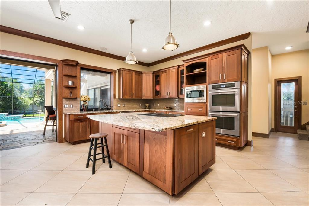 The amazing kitchen has everything you need to host any size gathering and opens up to the beautiful pool area for perfect indoor/outdoor entertaining. - Single Family Home for sale at 2209 87th St Nw, Bradenton, FL 34209 - MLS Number is A4431845
