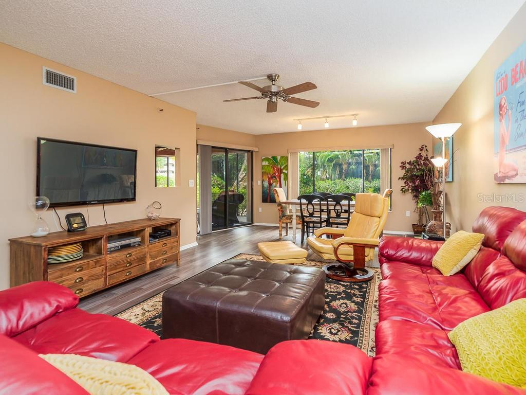 Spacious and open living room and dining room - Condo for sale at 131 Garfield Dr #1b, Sarasota, FL 34236 - MLS Number is A4432013