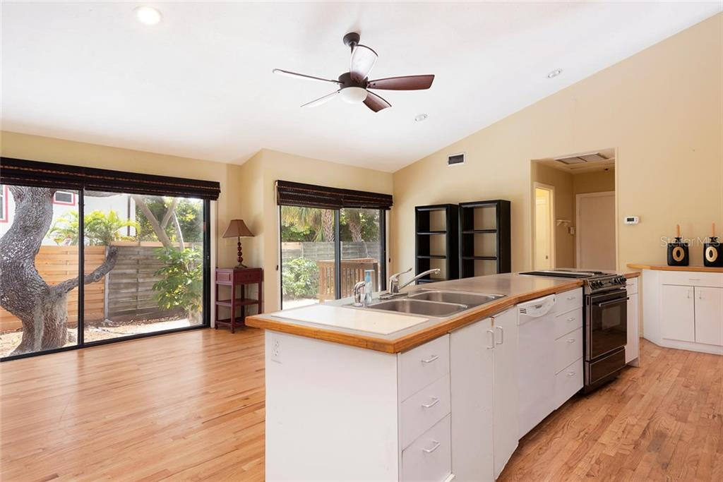 Open Kitchen with Island. - Single Family Home for sale at 1302 Roberts Bay Ln, Sarasota, FL 34242 - MLS Number is A4433097