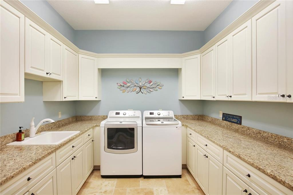 oversized laundry room - Single Family Home for sale at 1813 Boyce St, Sarasota, FL 34239 - MLS Number is A4433125