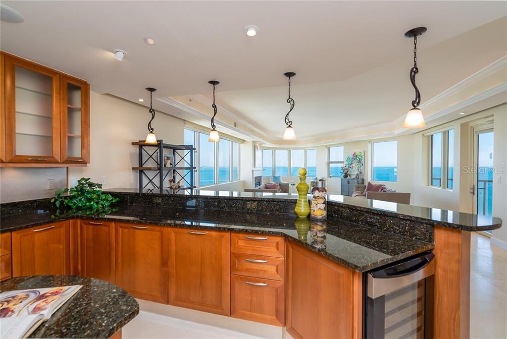 Plenty of space to prepare great meals, entertain, and Breakfast Bar space for your family & friends! - Condo for sale at 128 Golden Gate Pt #902a, Sarasota, FL 34236 - MLS Number is A4433296