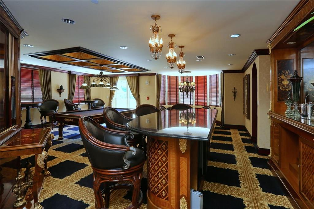 Social/Game Room includes a great bar, Billiards table, Card Table and More!! - Condo for sale at 128 Golden Gate Pt #902a, Sarasota, FL 34236 - MLS Number is A4433296