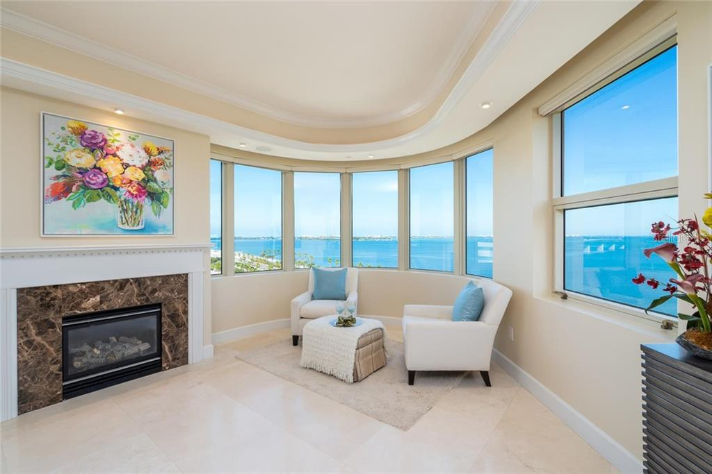 Lounge by the fire while watching boats cruise around the Harbor and Pelicans & Osprey fly right in front of your windows! - Condo for sale at 128 Golden Gate Pt #902a, Sarasota, FL 34236 - MLS Number is A4433296