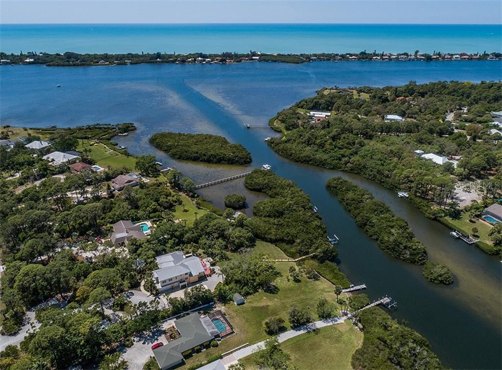 Aerial - Forked Creek and literally a minute to the Intracoastal Waterway (Lemon Bay) -- Gulf of Mexico in background. - Single Family Home for sale at 1361 Bayshore Dr, Englewood, FL 34223 - MLS Number is A4433943