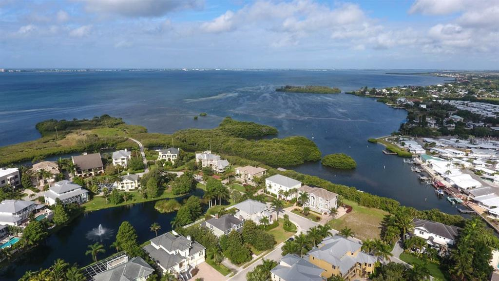 Aerial of neighborhood and Sarasota Bay. - Single Family Home for sale at 7153 Hawks Harbor Cir, Bradenton, FL 34207 - MLS Number is A4434661