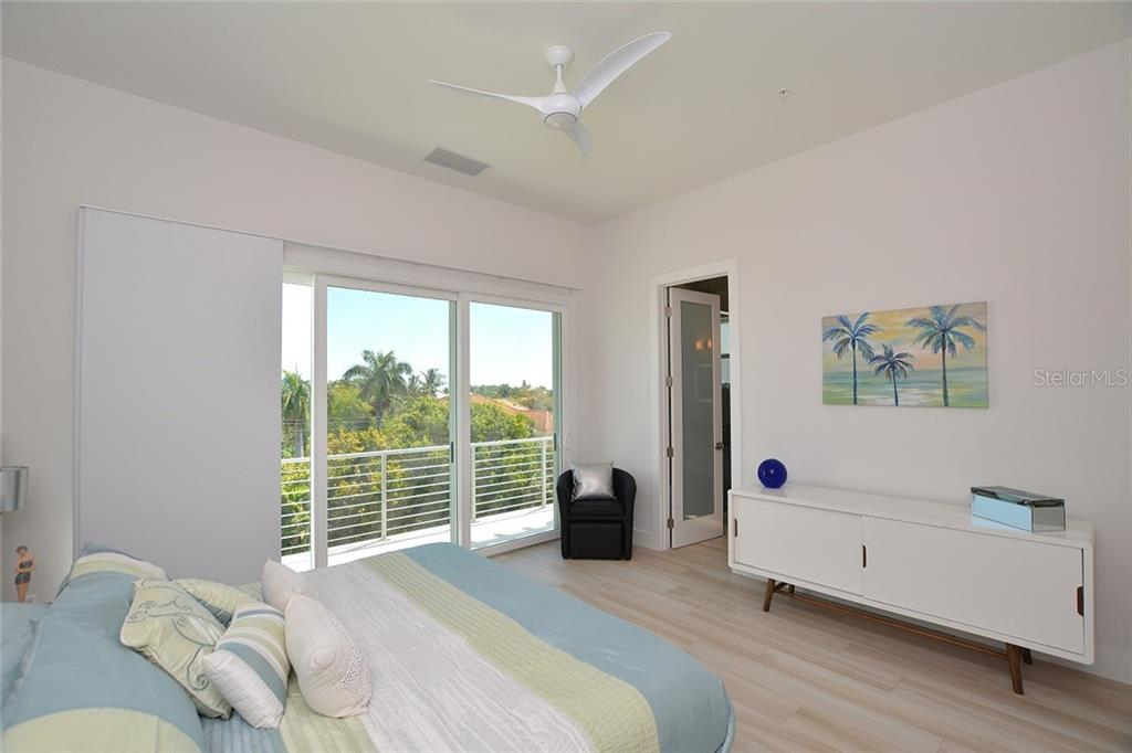 Bedroom 2 with private terrace and ensuite bath. - Condo for sale at 254 S Polk Dr #102, Sarasota, FL 34236 - MLS Number is A4434803