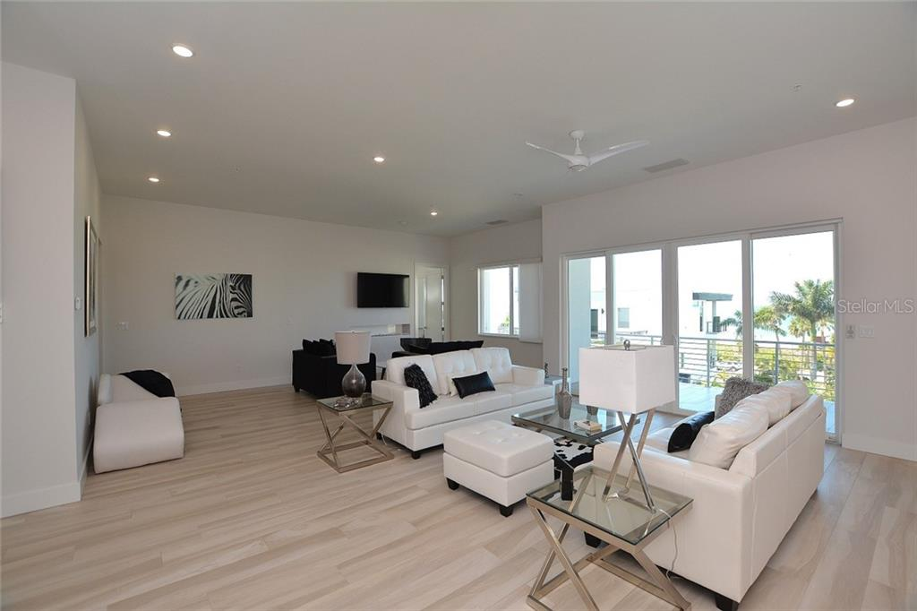 Sliders lead to an expansive private terrace with Gulf and beach views beyond. - Condo for sale at 254 S Polk Dr #102, Sarasota, FL 34236 - MLS Number is A4434803