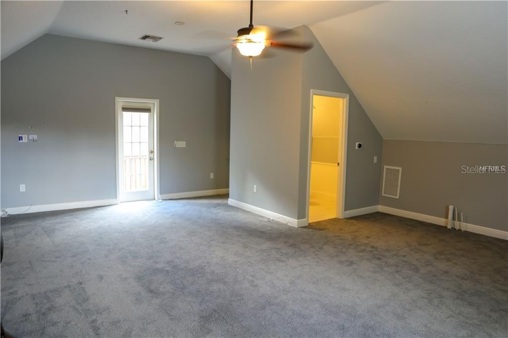 Bonus room with half bath with French door to private balcony above the pool patio... - Single Family Home for sale at 13825 18th Pl E, Bradenton, FL 34212 - MLS Number is A4435082