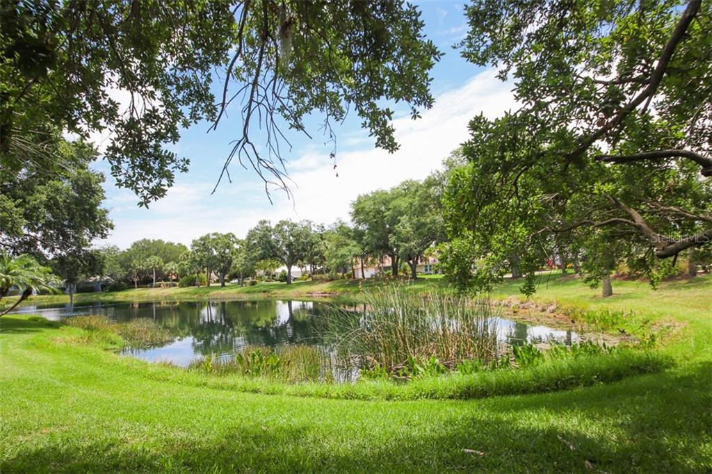 Lake view to the left - Single Family Home for sale at 4448 Deer Trail Blvd, Sarasota, FL 34238 - MLS Number is A4435495