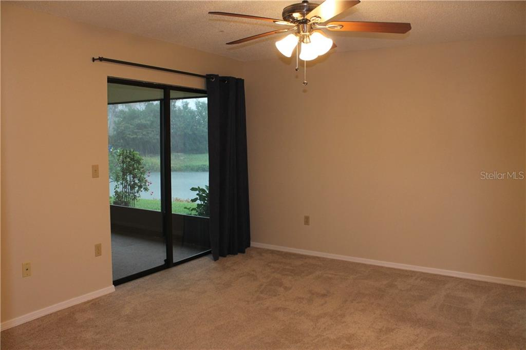 Sliding glass doors from the master bedroom to the patio. - Single Family Home for sale at 4803 Glenbrooke Dr, Sarasota, FL 34243 - MLS Number is A4435920