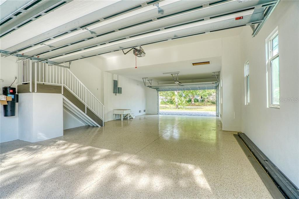 Spacious four car tandem garage which makes it easy to pull in and out, cured epoxy floor - Single Family Home for sale at 1555 Sandpiper Ln, Sarasota, FL 34239 - MLS Number is A4436047