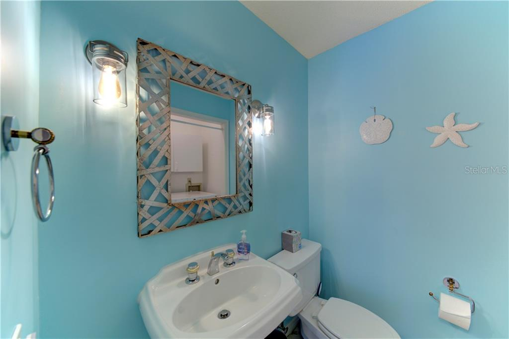 Bathroom and laundry room combo - Single Family Home for sale at 1202 N View Dr, Sarasota, FL 34242 - MLS Number is A4436092
