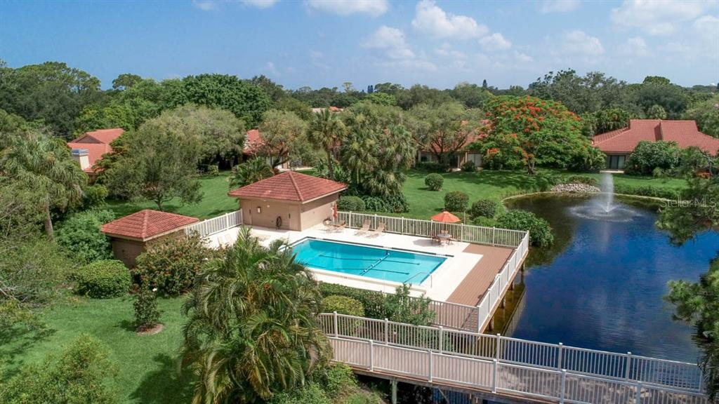 Aerial Carriage House 1 pool - Condo for sale at 1742 Landings Blvd #38, Sarasota, FL 34231 - MLS Number is A4439252