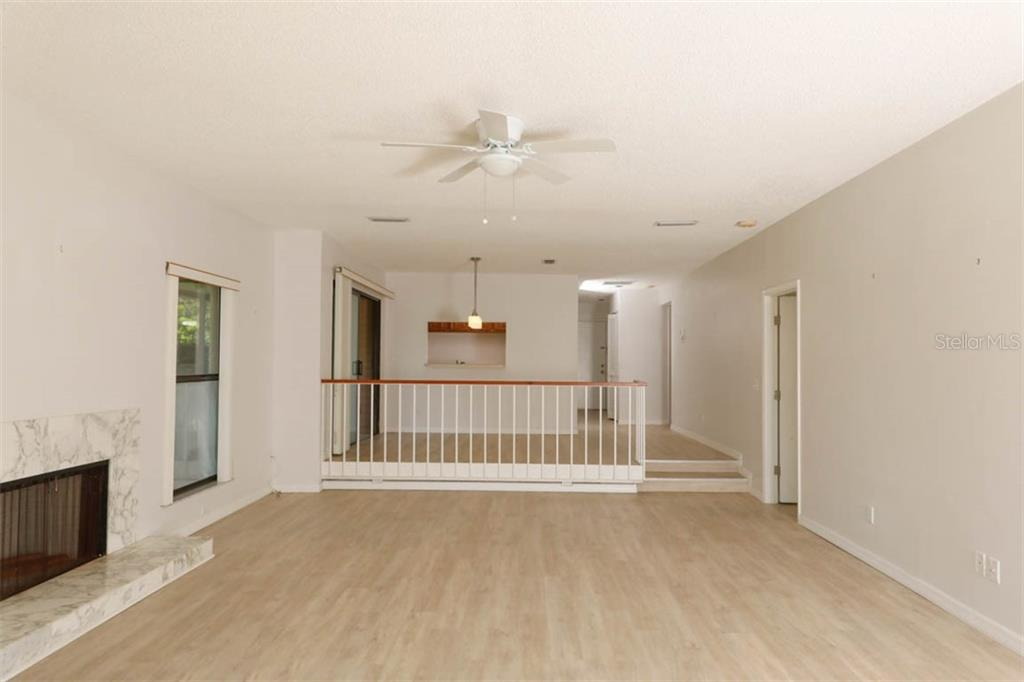 Fireplace, Living room and Dining area. - Condo for sale at 1742 Landings Blvd #38, Sarasota, FL 34231 - MLS Number is A4439252