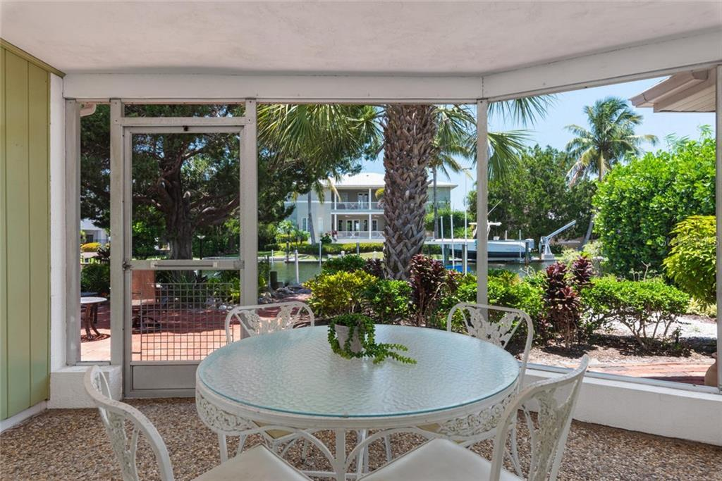 True vintage Florida charm on the screened in porch! - Single Family Home for sale at 701 Norton St, Longboat Key, FL 34228 - MLS Number is A4440596