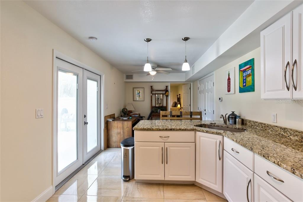 Kitchen with French doors to backyard. - Single Family Home for sale at 2322 Cadillac St, Sarasota, FL 34231 - MLS Number is A4440841