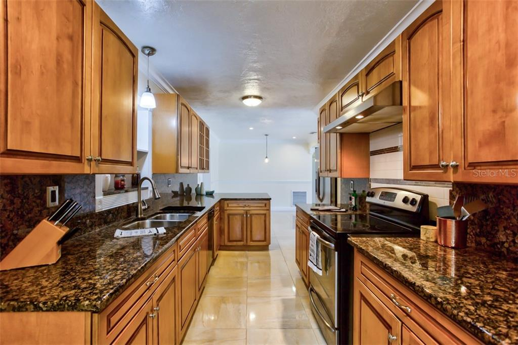 Main house kitchen. - Single Family Home for sale at 2322 Cadillac St, Sarasota, FL 34231 - MLS Number is A4440841