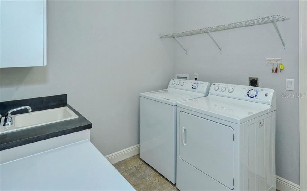 Laundry Room with additional sink and Freezer - Single Family Home for sale at 1696 Lancashire Dr, Venice, FL 34293 - MLS Number is A4441325
