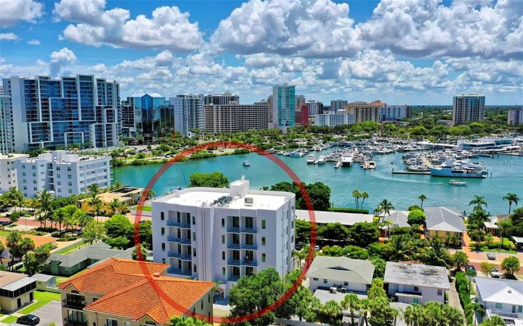 Walk to Marina Jack's for dinner, downtown to the Farmer's Market or a sunset stroll across the Ringling Bridge. - Condo for sale at 609 Golden Gate Pt #202, Sarasota, FL 34236 - MLS Number is A4441802