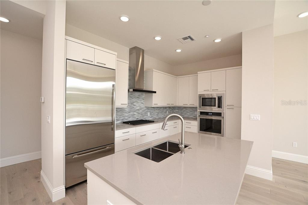 Jenn Air appliances, quartz countertops & solid wood Euro-Tech cabinetry. - Condo for sale at 609 Golden Gate Pt #202, Sarasota, FL 34236 - MLS Number is A4441802