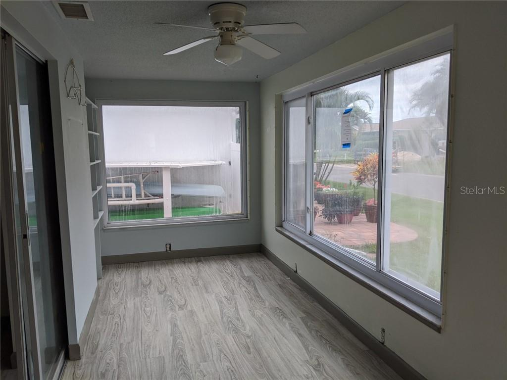 FLORIDA ROOM ACCESSIBLE FROM LIVING AREA AND MASTER BEDROOM AT REAR - Villa for sale at 869 Spanish Dr N #46, Longboat Key, FL 34228 - MLS Number is A4442020
