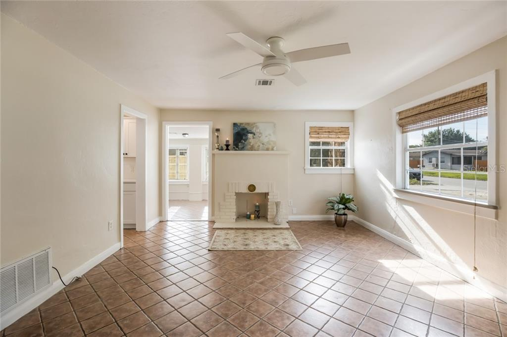 Living room is has updated ceiling fan. - Single Family Home for sale at 1763 6th St, Sarasota, FL 34236 - MLS Number is A4442510