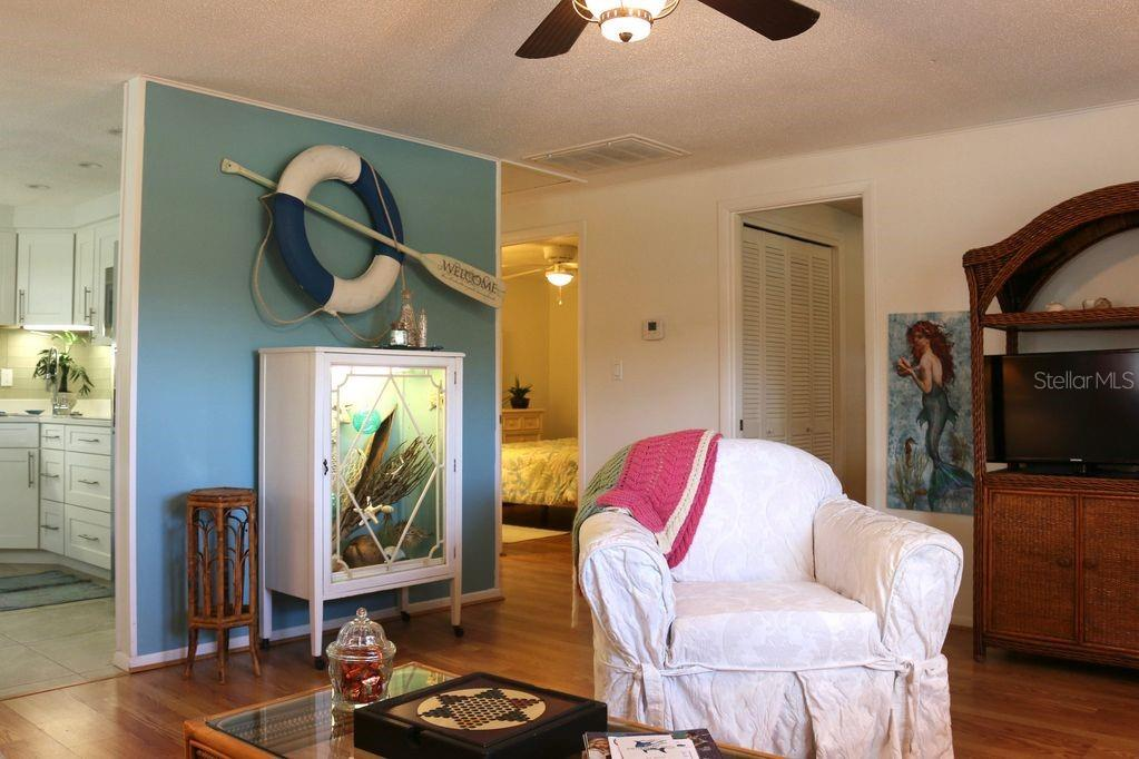 Oversized furniture with comfortable white slip covers.  Shadow box does not convey. - Duplex/Triplex for sale at 4418-4420 100th St W, Bradenton, FL 34210 - MLS Number is A4443821