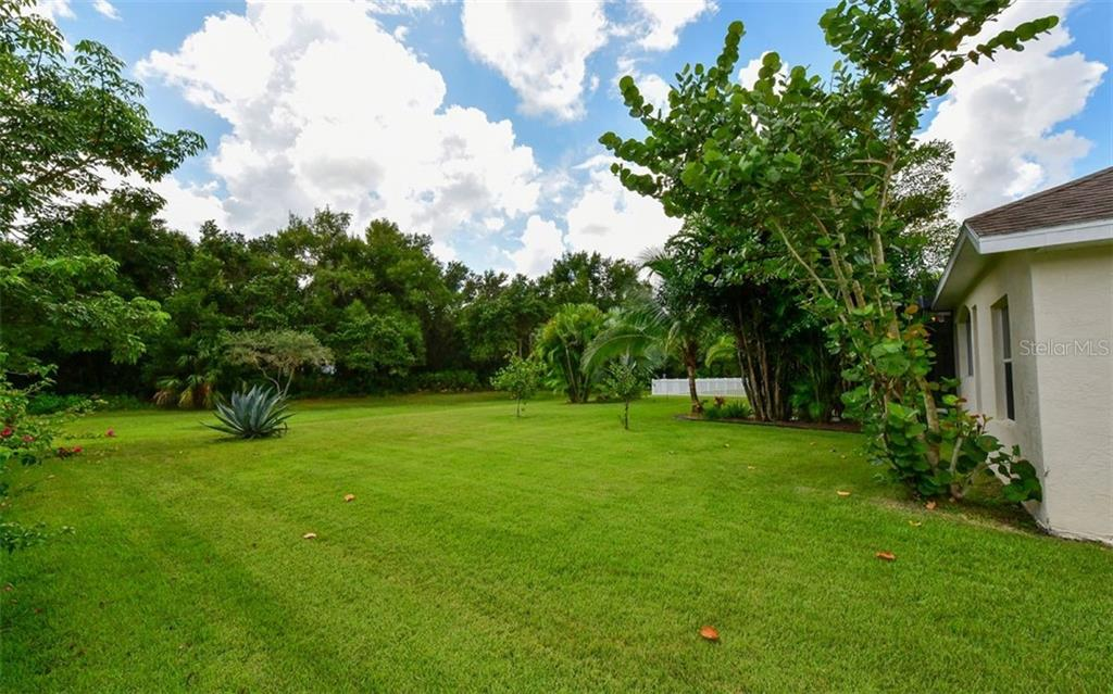 Side yard - Single Family Home for sale at 13022 Peregrin Cir, Bradenton, FL 34212 - MLS Number is A4444939