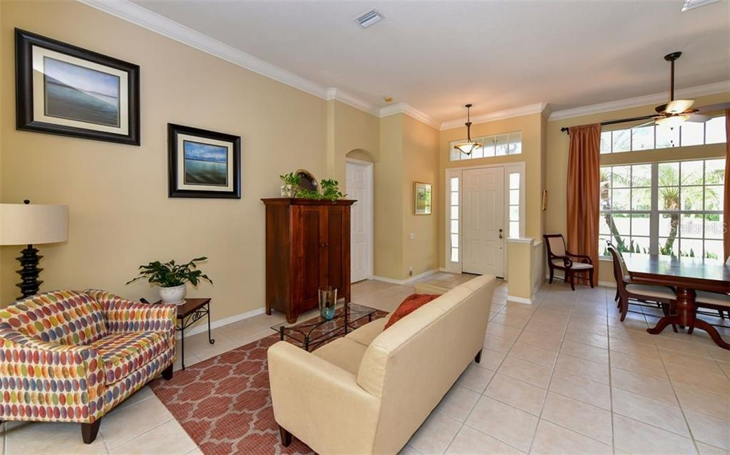 Living room with view of pool and part of backyard - Single Family Home for sale at 13022 Peregrin Cir, Bradenton, FL 34212 - MLS Number is A4444939