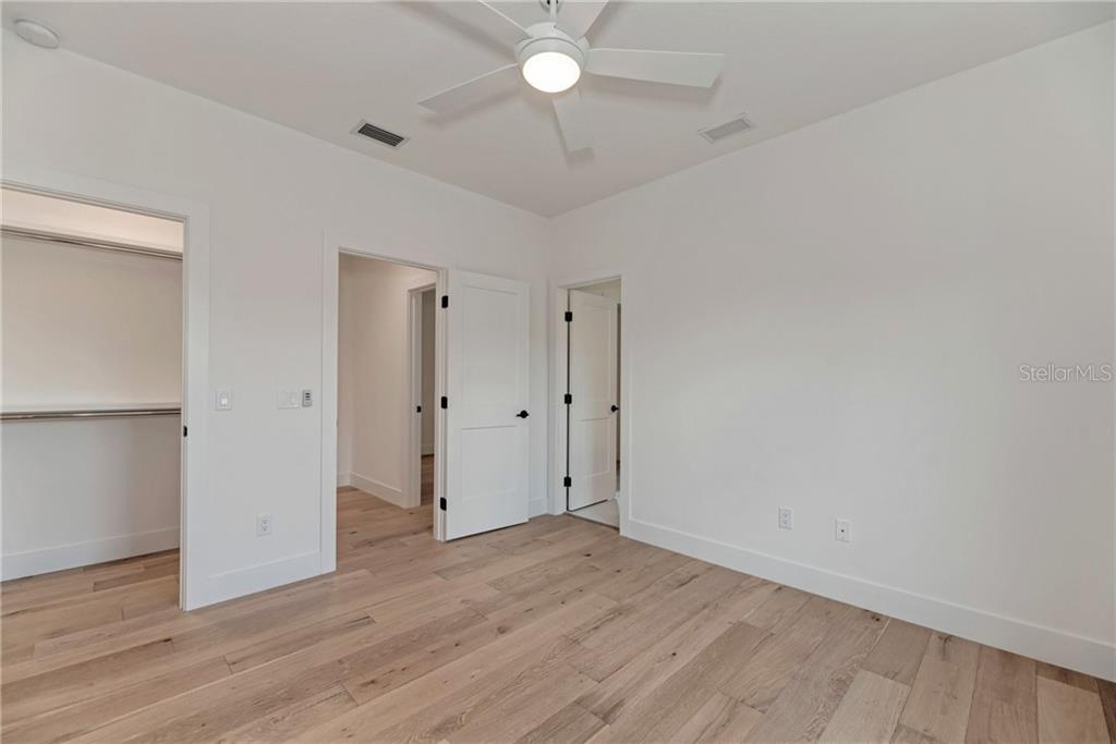 Walk-In Closets in both Guest Bedrooms - Single Family Home for sale at 5035 Sandy Beach Ave, Sarasota, FL 34242 - MLS Number is A4445640