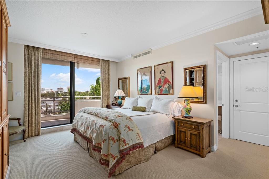Guest Bedroom | A richly appointed guest bedroom with private ensuite full bathroom.  City views bring the outside into the large a and comfortable space.  Access to the large guest terrace. - Condo for sale at 401 S Palm Ave #402, Sarasota, FL 34236 - MLS Number is A4446224