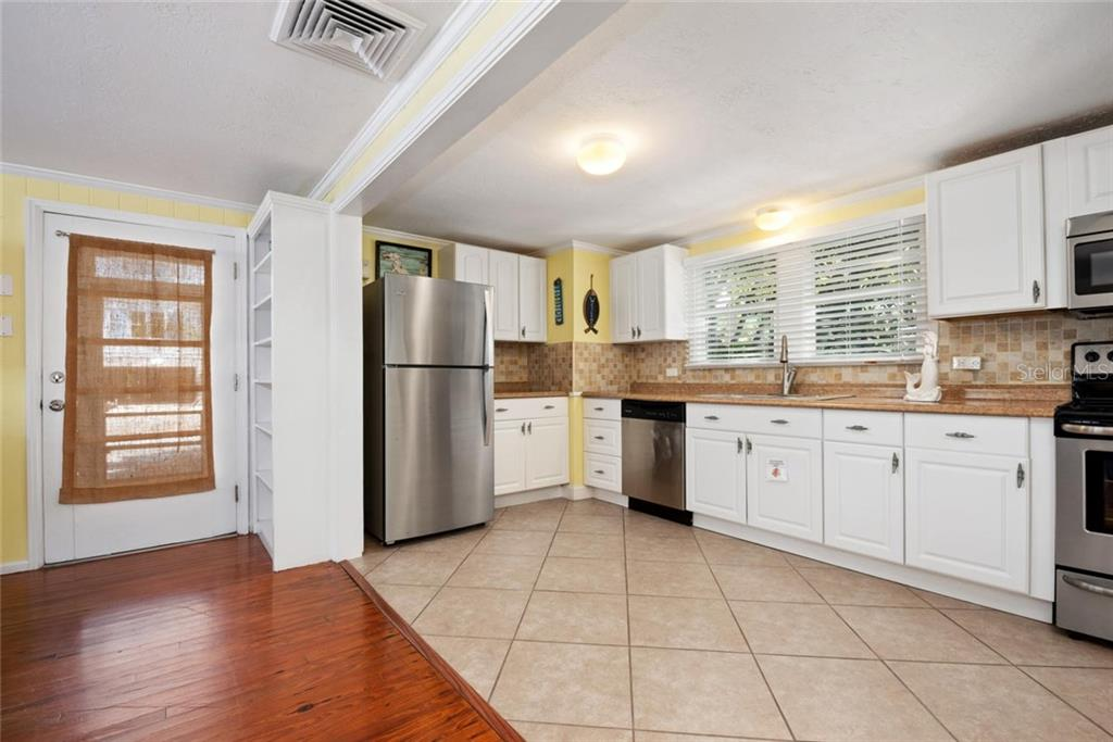 MERMAID kitchen. - Duplex/Triplex for sale at 516 Canal Rd, Sarasota, FL 34242 - MLS Number is A4446336