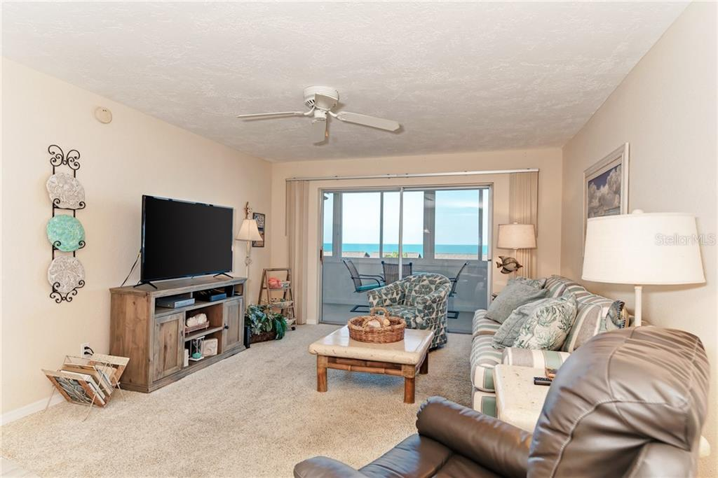 Comfortable living room opens to the lanai. - Condo for sale at 1080 W Peppertree Ln #406a, Sarasota, FL 34242 - MLS Number is A4446520