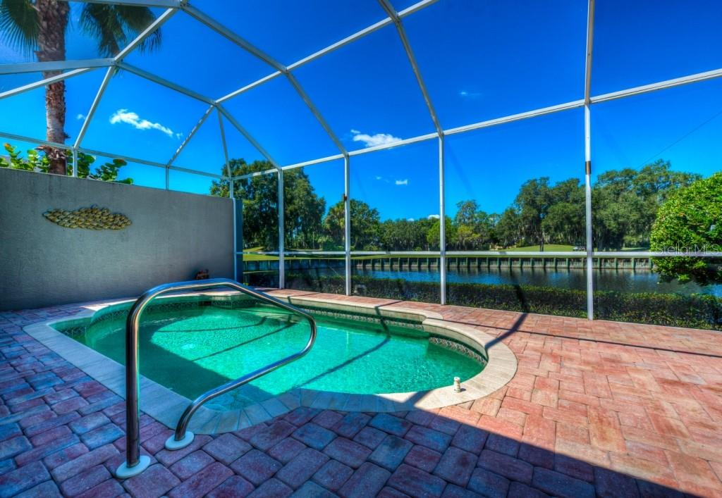 Ahhh.  Just relax! Nice pavers surround pool with room for chaise lounges at the end. Pond and golf course view. - Single Family Home for sale at 8727 53rd Ter E, Bradenton, FL 34211 - MLS Number is A4447005
