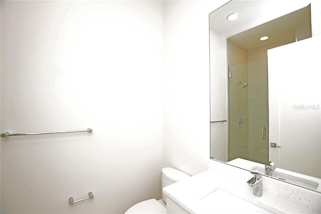 Bedroom 2 bath offers a tiled shower. - Condo for sale at 609 Golden Gate Pt #302, Sarasota, FL 34236 - MLS Number is A4447482