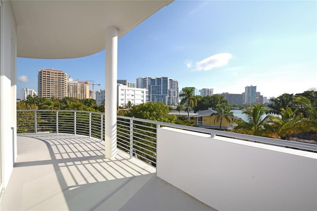 Unit 302 offers city views and a partial views of Sarasota Bay and nearby marina. - Condo for sale at 609 Golden Gate Pt #302, Sarasota, FL 34236 - MLS Number is A4447482