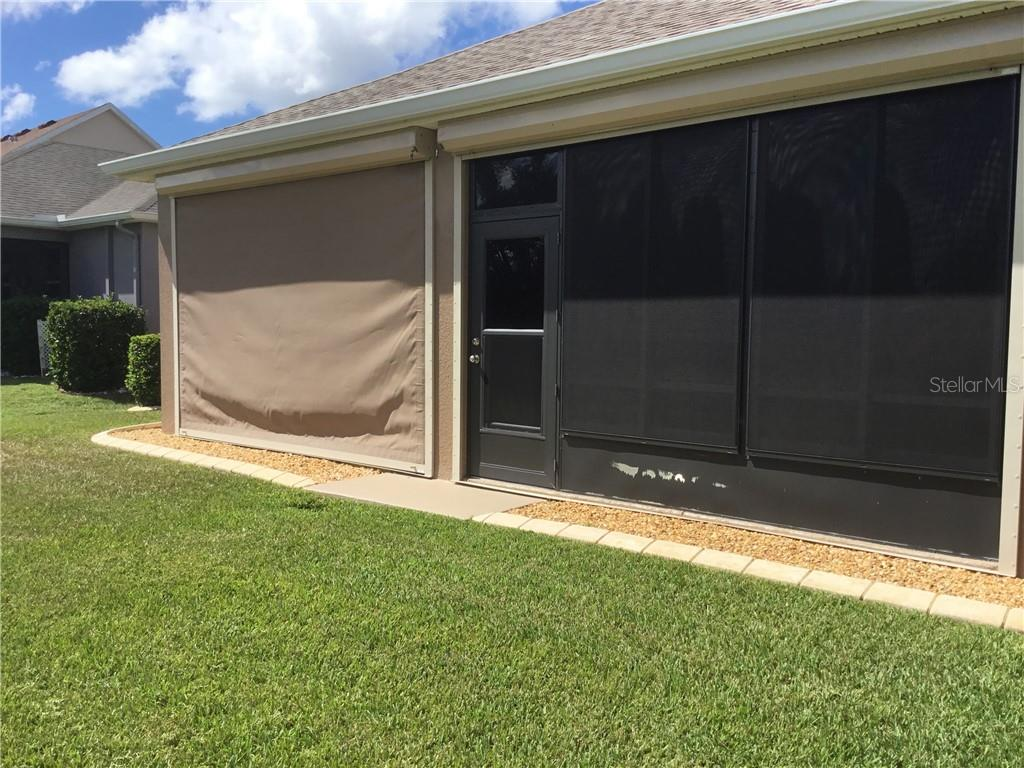 Automated Hurricane shutter on left is in the down position in this photo - Single Family Home for sale at 5727 Arbor Wood Ct, Bradenton, FL 34203 - MLS Number is A4448047